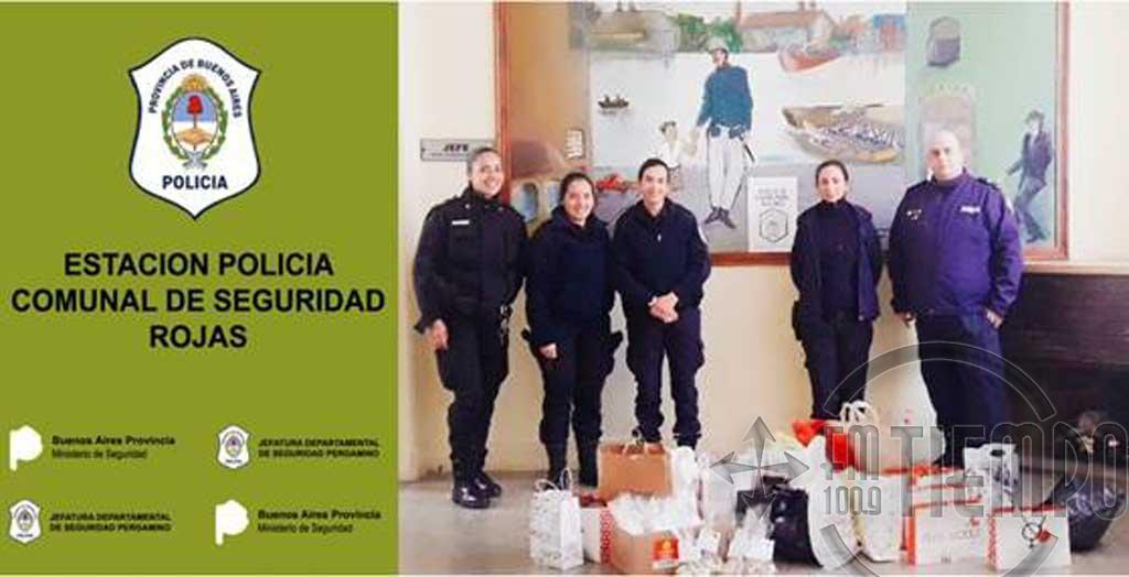 Entrega de juguetes recolectados por la estación de policía comunal de seguridad Rojas en campaña de donación del día del niño